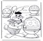 Zajączek Wielkanocnymaluje jajka